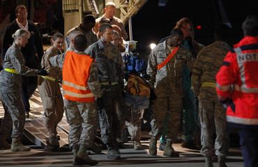 U.S. Air Force medical personnel carry an injured Libyan civilian at Ramstein air base in southwestern Germany