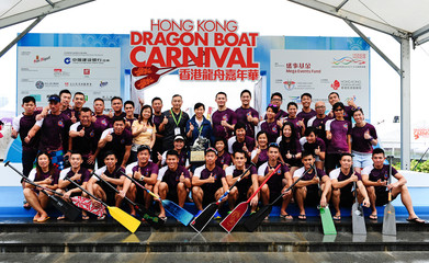 The bronze medallists of the Hong Kong Trophy pose for a picture. Hong Kong celebrates the Dragon Boat Festival with three days of races and parties as part of the 40th anniversary of international dragon boat racing.