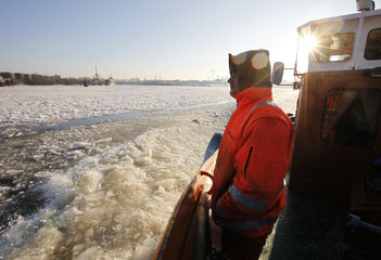 Machinst Meyer of icebreaker watches ice floes as they clear the waterway at the harbour in Hamburg