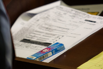 A pack of Bubblicious gum rests upon an Enterprise rental agreement on the lectern during the murder trial for former New England Patriots player Aaron Hernandez in Fall River