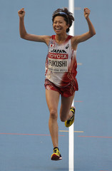 Fukushi of Japan celebrates after winning third place in the women's marathon during the IAAF World Athletics Championships in Moscow