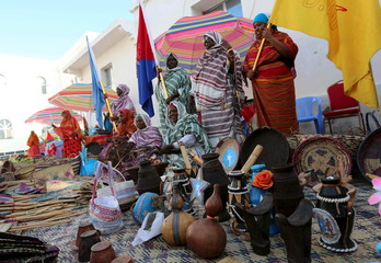 Somali women weave baskets during an event to showcase traditional Somali culture in Hamarweyne district in the capital Mogadishu