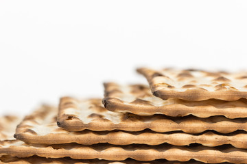 Passover matzah stack, edge view, close up.