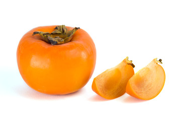 Fresh ripe persimmons isolated on white background.