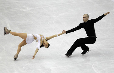 Vartmann and van Cleave of Germany perform during the pairs free skating event at the ISU World Figure Skating Championships in Nice