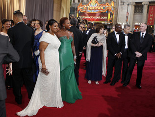 Octavia Spencer, winner of the best supporting actress Oscar, and Viola Davis, best actress nominee, pose together on the red carpet at the 84th Academy Awards in Hollywood