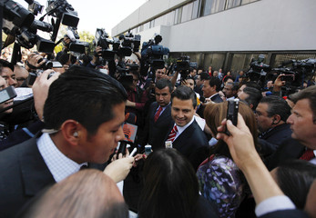 Enrique Pena Nieto of Mexico's Institutional Revolutionary Party (PRI) leaves the Federal Electoral Institute after registering as a presidential candidate for the upcoming July 1 federal elections at the Federal Electoral Institute in Mexico City