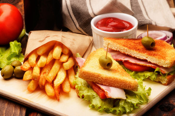 Freshly clubsandwiches with sauce and french fries