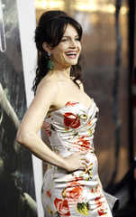 """Cast member Carla Gugino poses at the premiere of """"Sucker Punch"""" at the Grauman's Chinese theatre in Hollywood"""