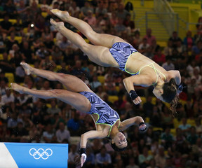 Canada's Meaghan Benfeito and Roseline Filion perform a dive during the women's synchronised 10m platform final at the London 2012 Olympic Games at the Aquatics Centre