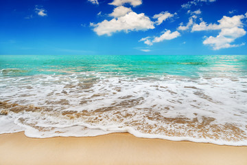 Beach sand and blue sea in blue sky