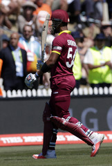 West Indies batsman Lendl Simmons salutes the crowd as he leaves the field during their Cricket World Cup match against Ireland in Nelson