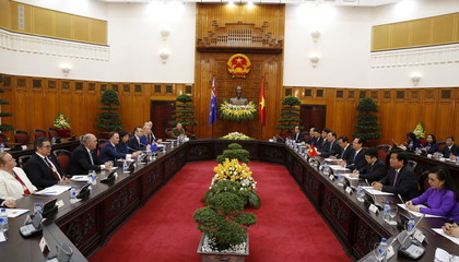 New Zealand's PM Key and his Vietnamese counterpart Dung talk at the Government Office in Hanoi