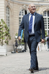 France's Labour, Employment and Social Dialogue Minister Sapin arrives for a meeting with France's Prime Minister and labour union representatives at the Hotel Matignon in Paris