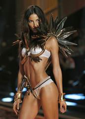 Model Lily Aldridge presents a creation at the 2014 Victoria's Secret Fashion Show in London