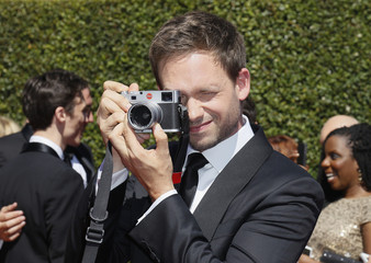 Patrick Adams takes a photo of photographers with a Leica camera at the 2014 Creative Arts Emmy Awards in Los Angeles