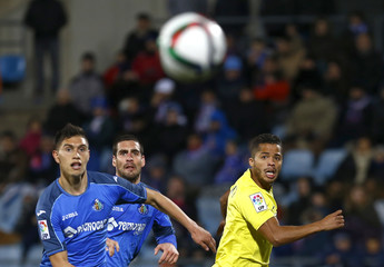 Getafe's Velazquez, Arroyo and Villarreal's Dos Santos eye the ball during their Spanish King's Cup quarterfinal second leg soccer match in Getafe