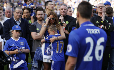 Chelsea's John Terry celebrates with wife Toni after winning the Premier League