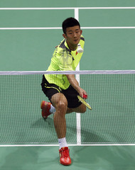 China's Chen returns a shot to Russia's Malkov during their men's singles match in the Thomas Cup badminton championship in New Delhi