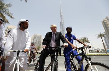London Mayor Johnson cycles near the Burj Khalifa boulevard in downtown Dubai, during his visit to the Emirate