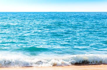 Ocean surface with waves near the beach