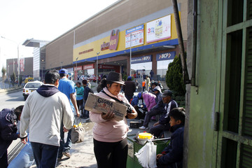 People walk outside a shopping mall at Huancayo city