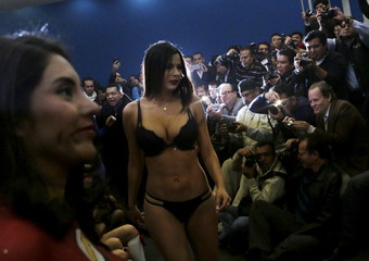 """Exotic dancers pose for the media during a news conference to promote the """"Sex and Entertainment Expo"""" adult exhibition at the Palacio de los Deportes in Mexico City"""