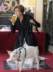 British actress Thompson drinks a pint from the pub her star is in front of as she poses after being honored for her motion picture career with a star on Hollywood Walk of Fame, in Hollywood