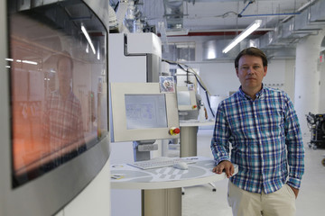 Weijmarshausen , CEO and co-founder of Shapeways 3D printing, poses at his office in the borough of Queens in New York