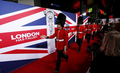 """People dressed as members of the Queen's Guard are seen at the premiere of the movie """"London Has Fallen"""" at the ArcLight Cinerama Dome in Los Angeles, California"""