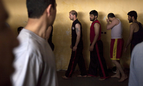 Afghan inmates attend a martial art class at the Kabul's Pul-i-Charkhi prison during a media visit organized by Afghanistan's Sports Persuasive Foundation