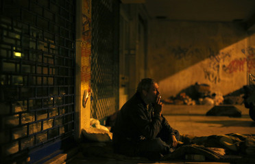 Alexandro, 48, who has been living on the streets for five years, smokes where he sleeps every night in Lisbon