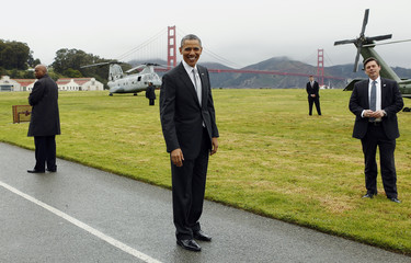 U.S. President Obama smiles as he prepares to board Marine One to a Democratic fund raiser in San Francisco
