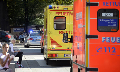An employee of the WHO, who contracted Ebola in Sierra Leone, arrives at the 'Universitaetsklinikum Hamburg-Eppendorf ' (University Clinic Eppendorf- UKE) in an ambulance, in Hamburg