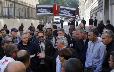 Workers of SNCM (National Maritime Corsica Mediterranean company) leave the courthouse in Marseille