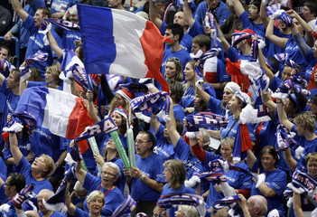 France's fans cheer for Clement and Llodra as they play against Serbia's Troicki and Zimonjic during their Davis Cup final doubles tennis match in Belgrade