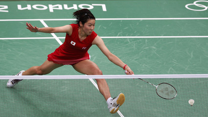 Japan's Sayaka Sato plays against Britain's Susan Egelstaff during their women's singles group play stage Group H badminton match during the London 2012 Olympic Games at the Wembley Arena
