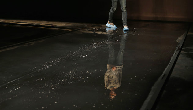 """Model wears protective shoe covers on catwalk during rehearsal before the Topman Design Autumn/Winter 2014 collection presentation during """"London Collections: Men"""" in London"""