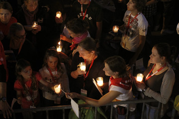 Faithful light candles during a Vespers service of Pope Benedict XVI at the fairground in the south-western German town of Freiburg