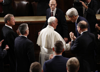 U.S. Secretary of State John Kerry talks with Pope Francis before the pontiff's speech to the U.S. Congress in Washington