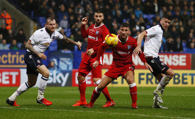 Bolton Wanderers' David Wheater and Gary Madine in action with Gillingham's Max Ehmer and Baily Cargill