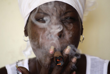 Cuban spiritualist, fortune teller and witch Mayra performs a Santeria ritual in her home in Havana