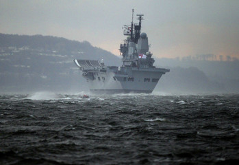 Britain's Royal Navy aircraft carrier HMS Ark Royal sails before being decommissioned into Scotland's Clyde river