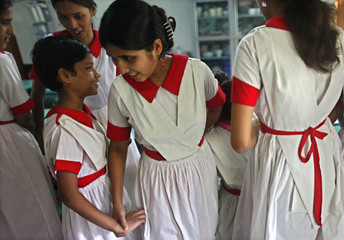 Meem chats with her friends at the Baptist Mission Integrated School in Dhaka