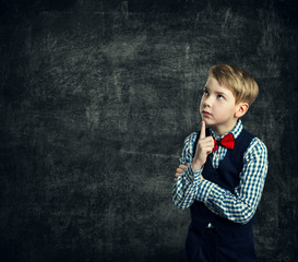 Child Thinking Bubble over Blackboard Background, School Boy Student ... Adobe Stock