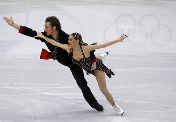 France's Pechalat and Bourzat perform during the ice dance compulsory dance figure skating competition at the Vancouver 2010 Winter Olympics