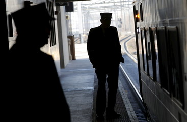 Conductors stand by a New Jersey Transit commuter train bound for New York City at the Secaucus Junction station in Secaucus