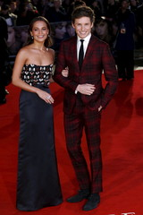 """Cast members Alicia Vikander and Eddie Redmayne pose as they arrive for the UK premiere of """"The Danish Girl"""" at Leicester Square in London"""