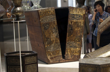 A visitor looks at an antique box designed to store the Koran at the re-opening of the newly renovated Islamic Museum in Old Cairo