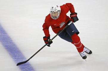 Team USA's team captain Duggan skates during their women's ice hockey team practice at the Shayba Arena ahead of the 2014 Sochi Winter Olympics